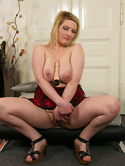 Hot housewife playing with her toy