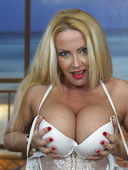 Steamy hot big breasted MILF getting naughty