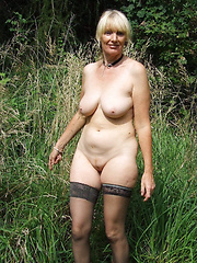 Naked mature amateurs in a naked nature