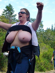 Mature plumpers showing their big tits on public event