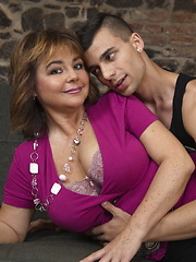 Big breasted mature lady doing her toy boy