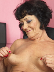 Horny mature lady playing with herself