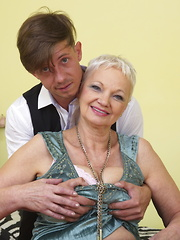 This naughty mature lady loves playing with her toy boy