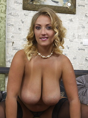 Big breasted mom playing with her wet pussy