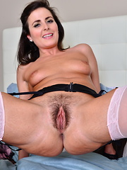 Hairy British mom getting wet on her bed