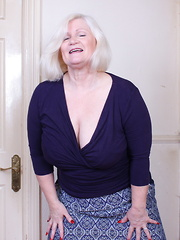 Big breasted British mature lady playing with herself